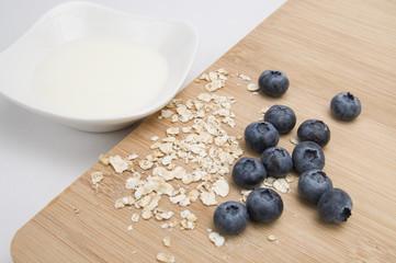 Oats, Bluberries, Milk and Wood Cutting Board