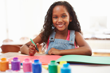 Girl Painting Picture On Table At Home