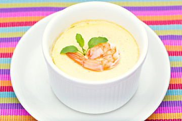 Steamed Egg with fresh shrimp in white cup closeup