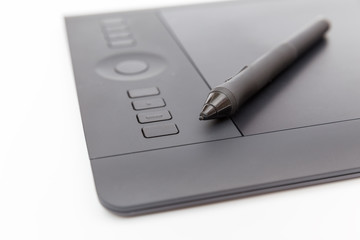 black drawing tablet with buttons and a special pen
