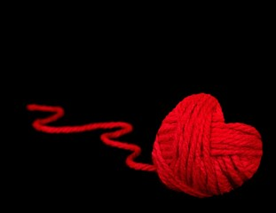 red heart ball of yarn on black