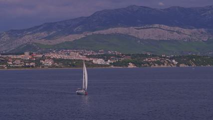 Yacht sailing coastal watters
