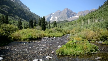 Maroon Bells with stream and blue sky, Colorado