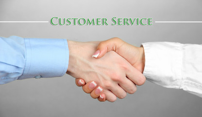 Business handshake symbolizing support and customer service