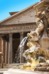 Fountain and the Pantheon in Rome, Italy. Closeup