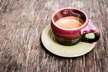 An elephant cup of espresso on wooden background