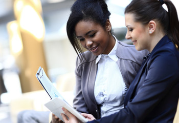 Businesswomen With documents and folder Sitting In Modern Offic