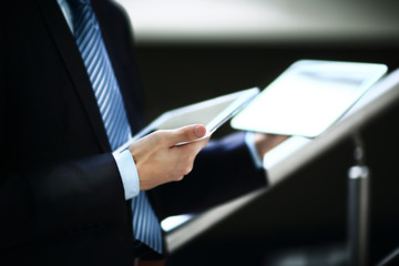 close up hands multitasking man using tablet, laptop and