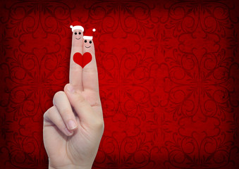 Conceptual Christmas fingers in love
