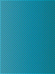 Metal perforated texture blue background
