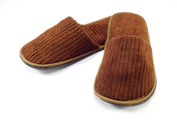 brown home slippers on white background