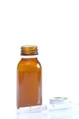 Syrup bottle with syringe.