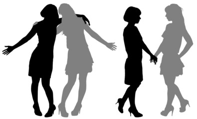 silhouette of two young women
