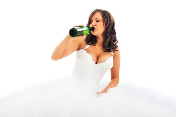 Young bride drinking beer