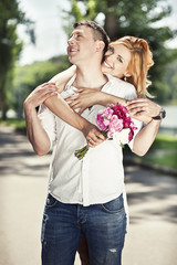 Beautiful couple embrace in the park