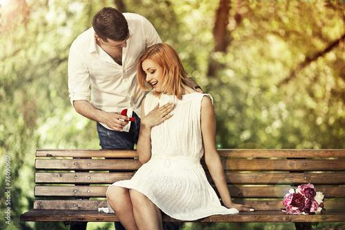 Leinwanddruck Bild Man making propose to his girlfriend
