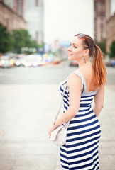 Beautiful young fashionable woman in the city
