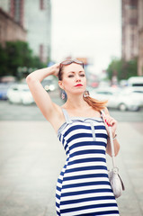 Young beautiful fashionable woman in the city