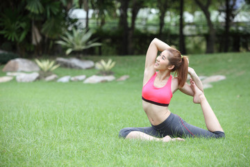 Young woman practicing yoga, eka pada Rajakapotasana (King Pigeo