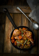 chicken with mushrooms and vegetables, stewed in wine.