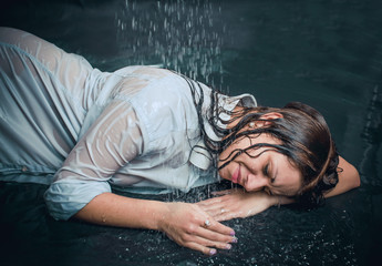 Portrait of the girl under drops