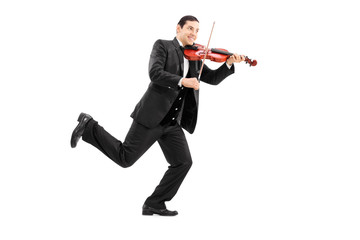 Man running and playing a violin