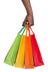 Male hand holding shopping bags isolated on white