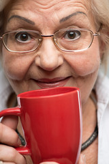 Elderly woman with cup of coffee