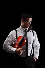 Vertical shot of a musician holding a violin