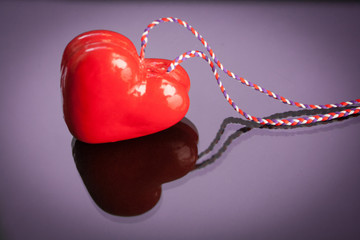 Red gift heart with reflection