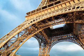 Lacy arches of the Eiffel Tower in Paris, France.