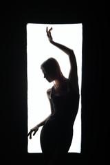 Harmonous girl dancing at camera