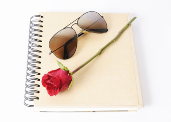 rose withers and sunglasses on book Isolated