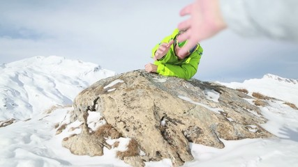 Man offering helpig hand-Hiking in winter