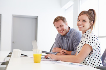 Man And Woman Working Together In Design Studio