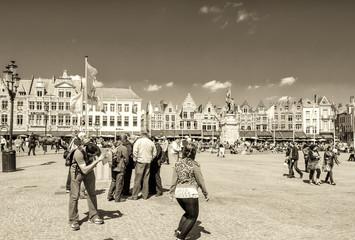 BRUGES, BELGIUM - MAY 15, 2012: Tourists enjoy city life on a be