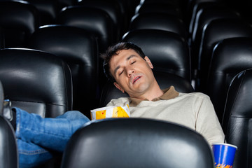 Bored Man Sleeping At Theater
