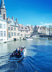 BRUGES, BELGIUM - MAY 15, 2012: Tourists enjoy city life on a be