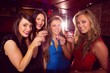 Pretty friends drinking shots together - 76096615