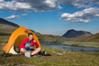Hiker takes the evending lunch in front of his tent