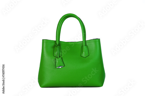 Leinwandbild Motiv Bolso de mujer verde sobre fondo blanco
