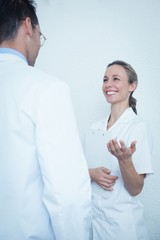 Smiling dentists in discussion