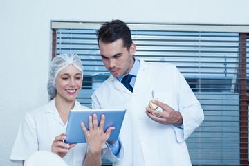 Dentists using digital tablet