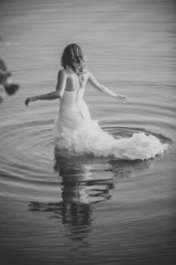 bride on the water in the lake