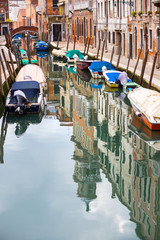 Empty gondolas moored in water canal
