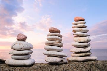 Three piles of white pebbles