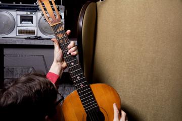 Man takes guitar.