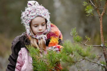 Cute little girl during a promenade out in the nature