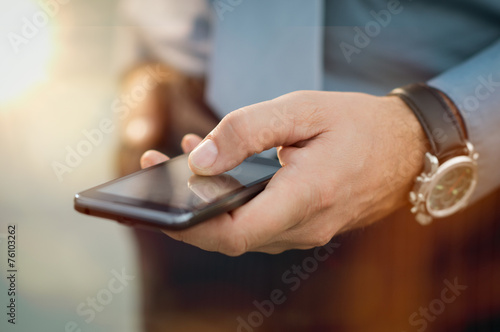 Businessman With His Smartphone poster