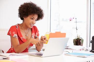 Woman Working At Desk In Design Studio